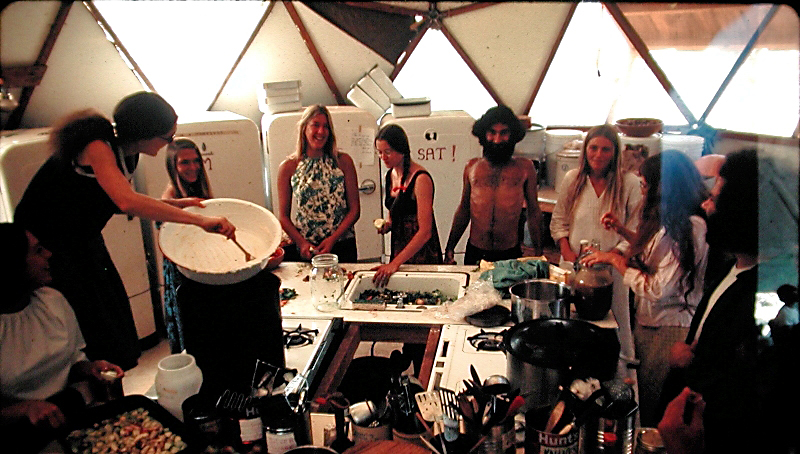 Ananda Meditation Retreat kitchen 1971. At left, stirring is Asha.