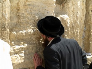 Orthodox Jew worships at the Wailing Wall.