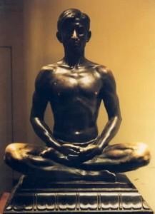 bronze statue of man meditating