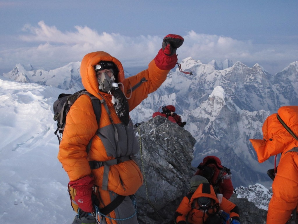 Climbers at the summit of Mt. Everest, 29,028' altitude. Click to enlarge.