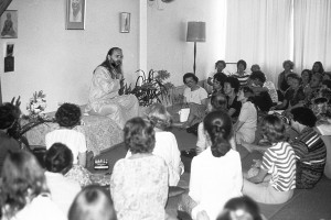 """Swami Kriyananda gives a talk during a """"Joy Tour."""" Swamiji's constant message was that all problems can be solved by inner communion in meditation with the joy of God. Click to enlarge."""