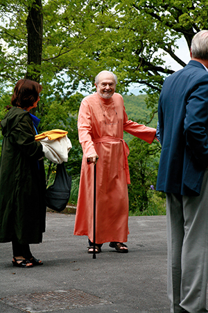 Swami Kriyananda in Assisi, walking with a cane.
