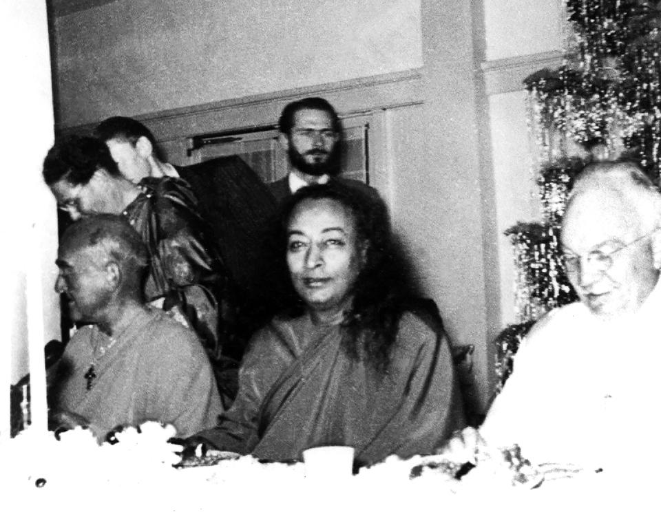 L-R: Yogananda's most advanced disciple, Rajarsi Janakananda; Swami Kriyananda (standing), Paramhansa Yogananda, and Dr. Lewis, Yogananda's first disciple in America.