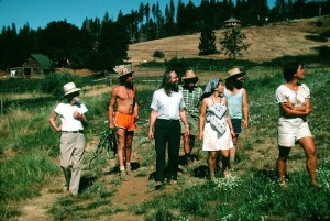 A simple life, close to the land. From left, Haanel Cassidy, Ananta, Swamiji, Govinda, Shivani, James Robinson, Maria. (Click to enlarge.)