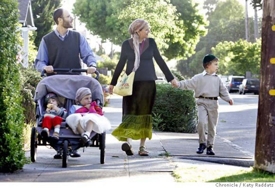 An Orthodox family walk to synagogue on the Sabbath in Berkeley, CA.