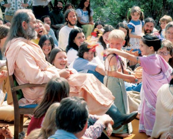 "Swami's birthday party at the ""birthday meadow"" in a hidden vale near the then-future site of the Expanding Light guest retreat. Photo taken in 1976 by Nayaswami Rambhakta."